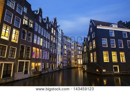 Famous view of Amsterdam canal at night, Netherlands