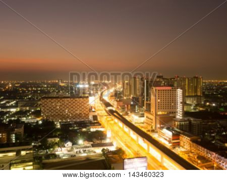 Blurred road and city at night with traffic lights in motion
