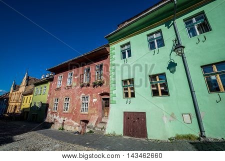 Old tenement house in Sighisoara town in Romania