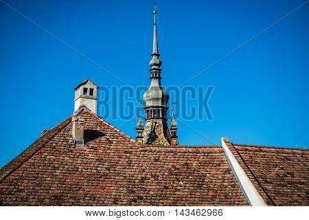 Spire of Clock Tower in Sighisoara town in Romania