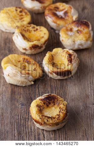 pasteis de nata a portuguese sweet on wood
