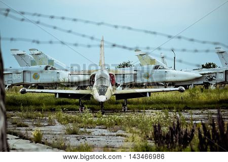 Old airfield Bila Tserkva Ukraine July 7 2013: - old aircraft on the airfield overgrown with barbed wire