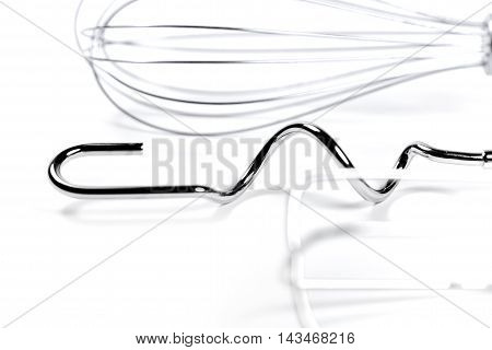 Baking equipment, wire whisk and egg beater, isolated on white.