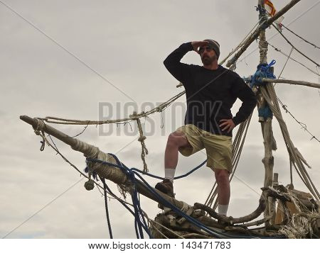 HOYLAKE, ENGLAND, JUNE 24. The Grace Darling on June 24, 2016, in Hoylake, England. A tourist stands on the prow of the Grace Darling pirate ship art installation in Hoylake England.