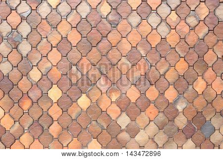 surface of the brown tiles wall for the design background.