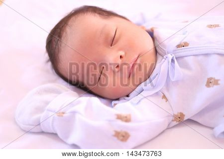 Asian baby is sleepingNewborn at this age want to sleep as much to growth.