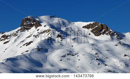 Ski slopes in the Flumserberg ski area Swiss Alps.