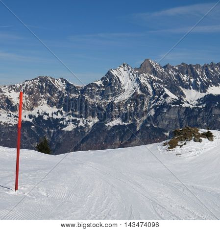 Scene in the Flumserberg ski area Switzerland. Slope and mountains of the Churfirsten Range.