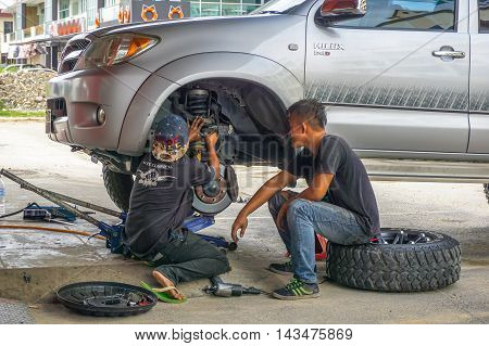 Kota Kinabalu,Sabah-Aug 11,2016:The car mechanics garage doing maintenance car shock absorber at Kota Kinabalu,Sabah.Shock absorbers can also leak as they are filled with oil.