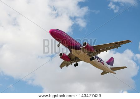 LUTON UK - 03 AUGUST 2016: Jet plane of low cost airlines Wizzair landing at London Luton airport