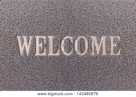 Welcome Gray Door Mat. Welcome Carpet Background. Welcome Gray Sign.