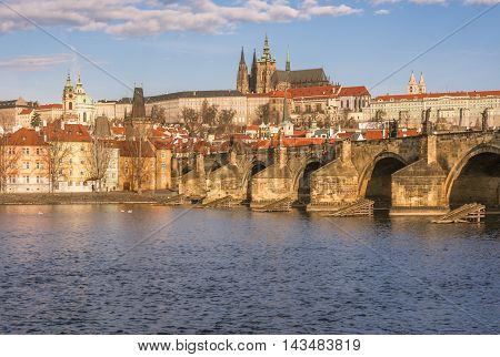 Charles Bridge over the river Vltava in Prague - Cityscape with a section of the Charles Bridge and the river Vltava, which crosses Prague, Czech Republic.