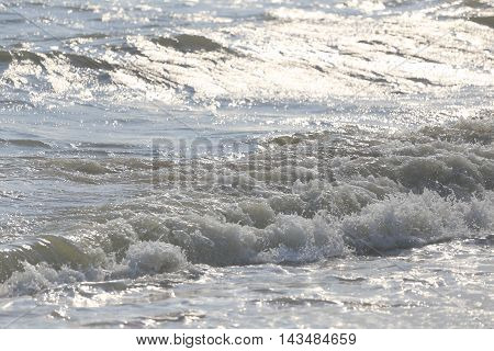 waves that swept on the beach for design nature background.