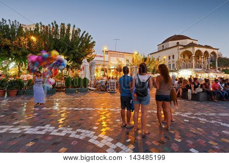 ATHENS, GREECE - AUGUST 20, 2016: People near the mosque in Monastiraki square in Athens on August 20, 2016.