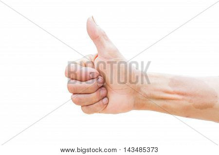 horizontal photo of closeup of farmer's hand showing thumbs up sign isolated on white background. Clipping path.