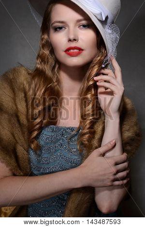 playful 1940s style woman portrait wearing white hat