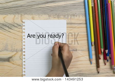 child's hand writing are you ready wood table colored crayons