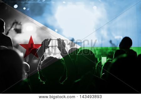 live music concert with blending Djibouti flag on fans
