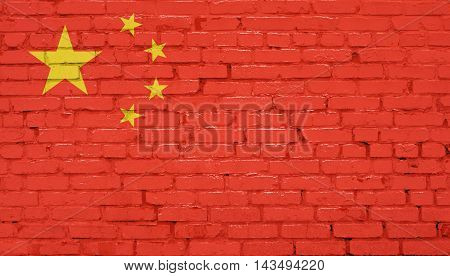 Grunge Chinese flag on wall. Abstract background