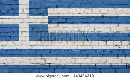 Flag of Greece Greek flag painted on brick wall.