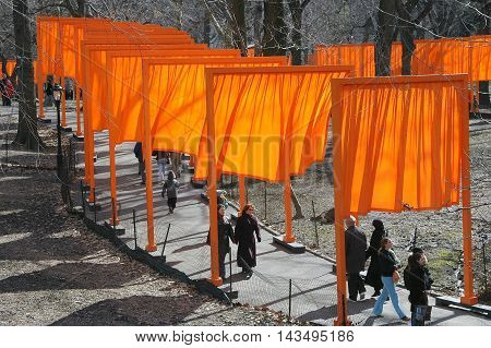 New York City - February 20 2005: Orange fabric panels comprise Christo's public art installation The Gates in Central Park