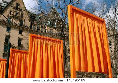 New York City - February 25 2005: Christo's The Gates public art installation in Central Park and the Dakota apartment building at West 72nd Street