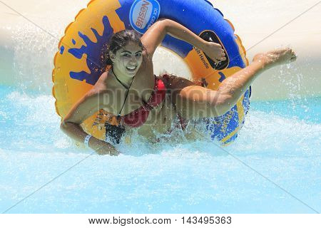 Rhodes Greece-August 14 2016:The girl after rafting slide in the Water park.Rafting slide is one of many popular game for adults and children in park.Water Water Park is located on the island of Rhodes in Greece and one of the most largest in Europe and i