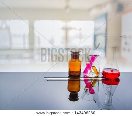 Glassware With Blur Laboratory In Background.