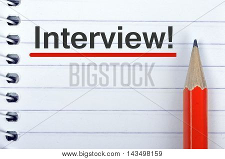 Interview text on notepad and red pencil