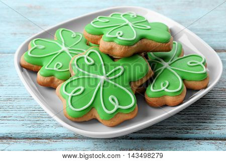 Decorative cookies on plate, closeup. Saint Patrics Day concept