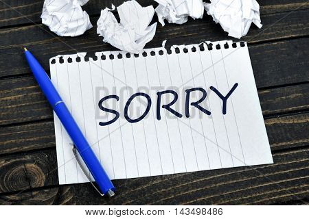 Sorry text on notepad and crippled paper