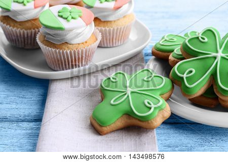 Tasty cupcakes and cookies on plate. Saint Patrics Day concept