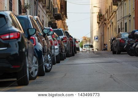 Typical old city street. Cars parked along the street in Gaeta Italy