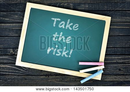 Take the risk text on school board and chalk
