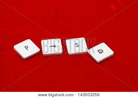picture of a The word PTSD written on red background.