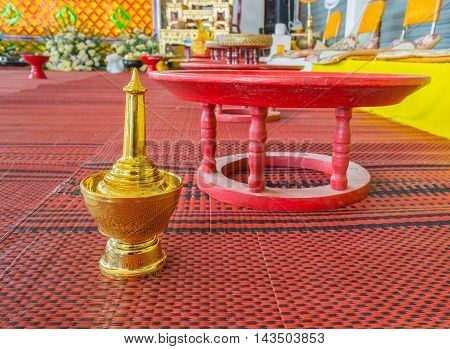 image of golden pour water containers for Buddhist death ceremony.