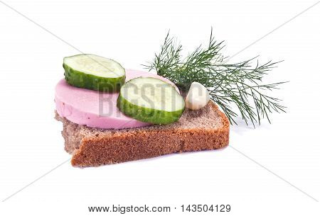 Sandwich with sausage cucumber dill and garlic is isolated on a white background