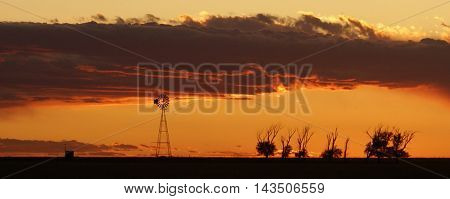 Vintage windmill on the Texas Panhandle sunset