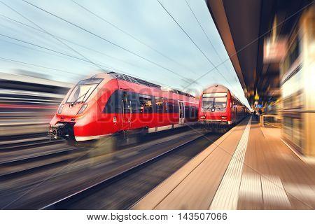 Modern High Speed Red Passenger Trains At Sunset. Railway Station