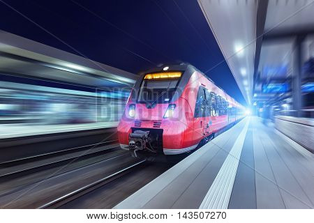 Modern High Speed Red Passenger Train At Night