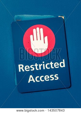 Grungy Restricted Access Sign With A Hand Symbol
