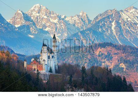 Neuschwanstein Castle In The Background Of Snowy Mountains