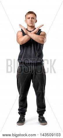 Full body portrait of handsome muscled young man making X sign with his arms isolated on white background. Fitness, sport, bodybuilding, workout. Body language. Prohibitions and restrictions.