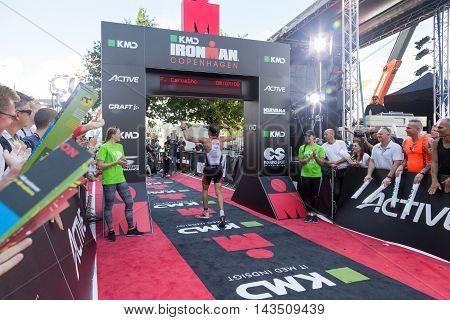 Copenhagen, Denmark - August 21, 2016: Triathlete Fabio Carvalho crossing the finish line as 3rd in men's in  08:07:10 at the KMD Ironman Copenhagen 2016