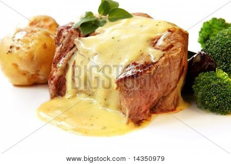 Filet Mignon ~ perfectly grilled thick-cut beef steak, with bearnaise sauce, baby roast potatoes, and broccoli.
