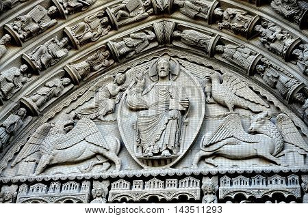New York City - June 16 2013: Christ in Majesty flanked by angels and mythical animals above the main entry portal at Riverside Church