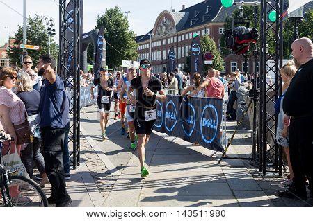 Copenhagen, Denmark - August 21, 2016: Triathletes running in the city center at the KMD Ironman Copenhagen 2016