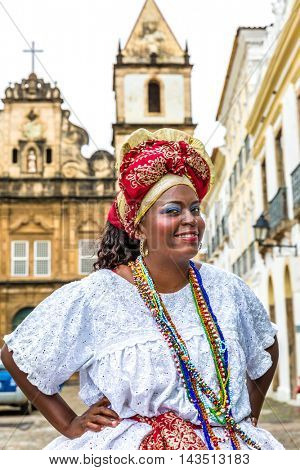 Brazilian woman of African descent wearing traditional clothes in Pelourinho, Bhia