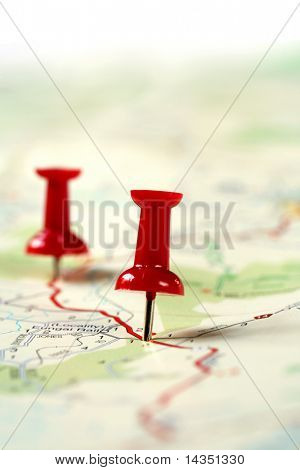 A map route marked with red push pins.  Shallow depth of field.