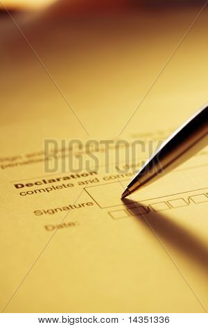 Pen signing declaration.  Silver and gold ballpoint.